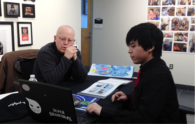 Pictured are Joe Sullivan (Society for History and Graphics) and VCD senior Alex Pak