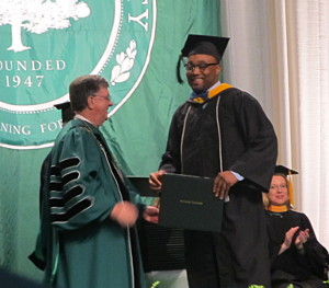 Travis Douglas at Commencement 2014