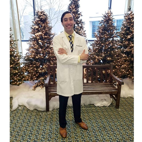 alum in white coat
