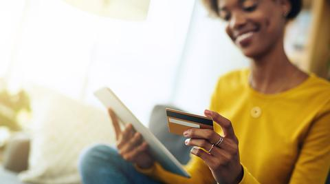 Woman online shopping with ipad and credit card