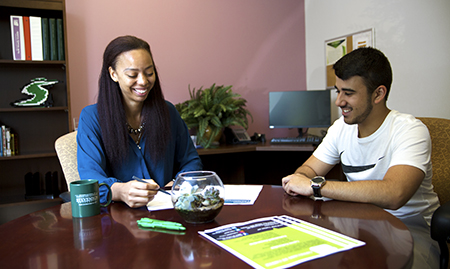 A student meeting with a Career Connection Center staff member