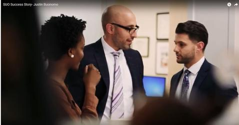 Justin talking with his coworkers at Johns Hopkins Hospital.