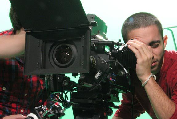 Student working with camera equipment