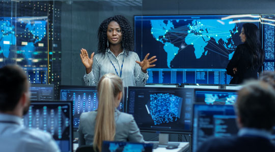 woman in cyber security leading a meeting