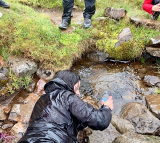 drinking from carbonated spring in Iceland