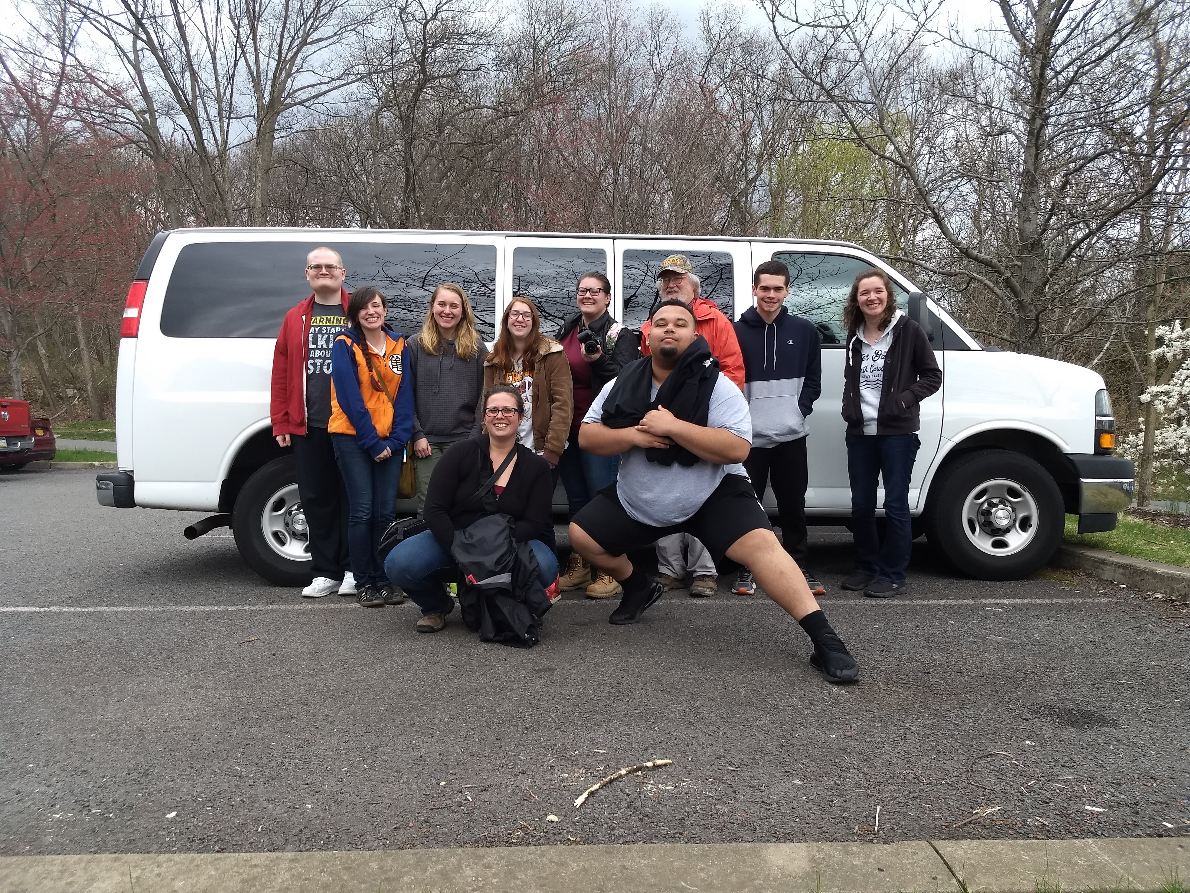 Picture of History majors in front of white 15 passenger van.
