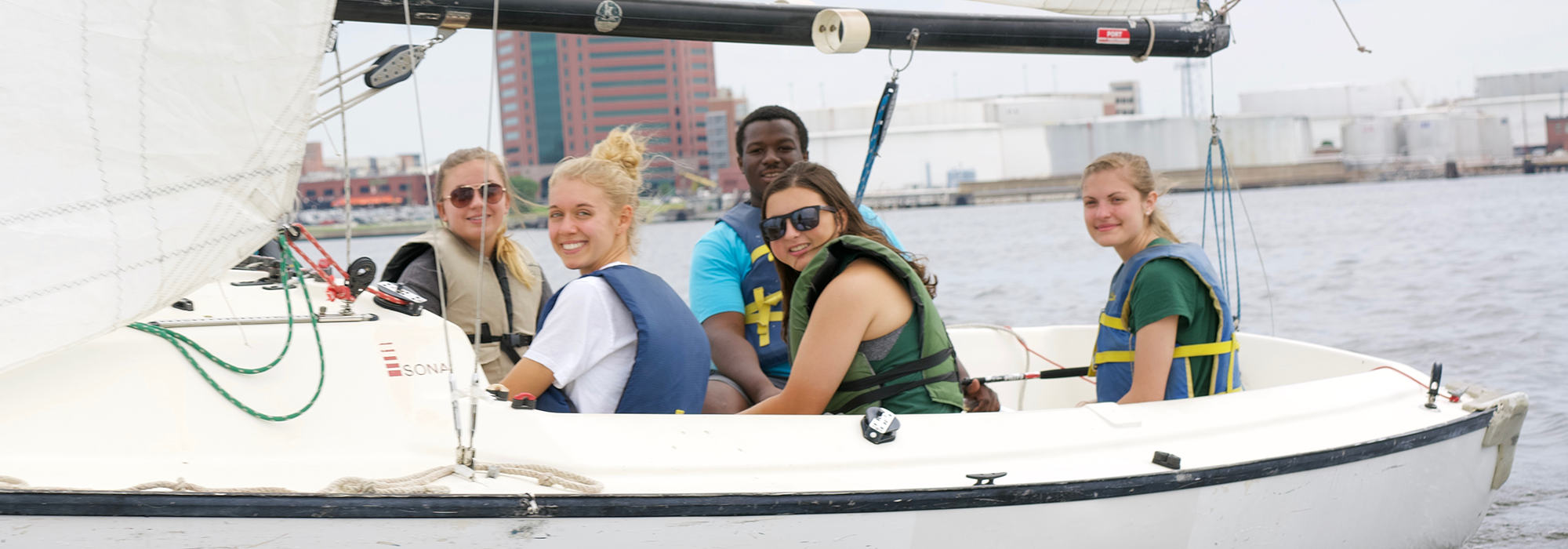 Stevenson students sailing in the Inner Harbor