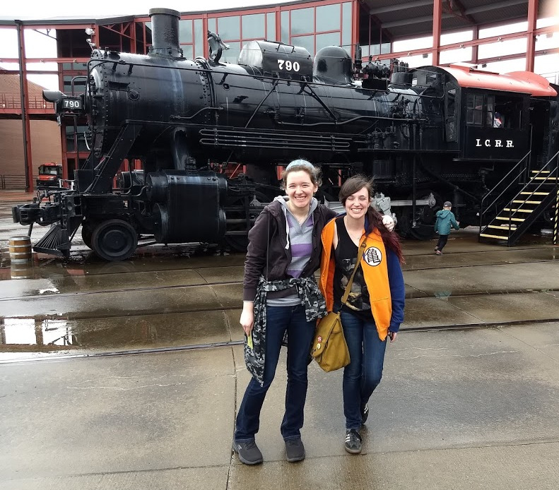 Two history majors standing in front of a steam locomotive at Steamtown National Historic Site